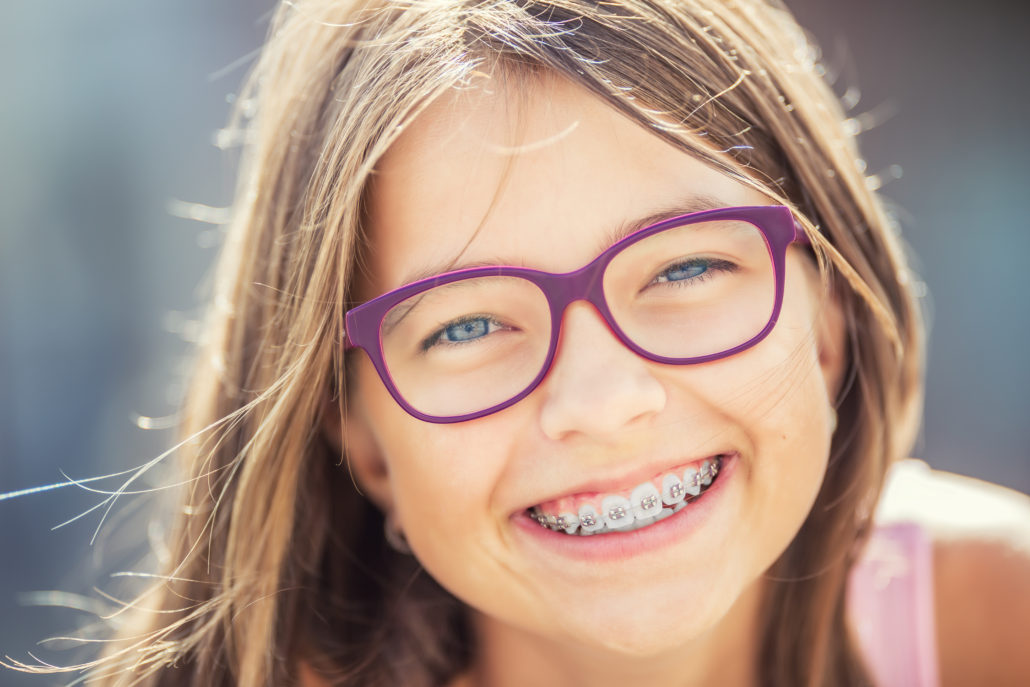 smiling girl with orthodontic braces (ottawa orthodontist blog)