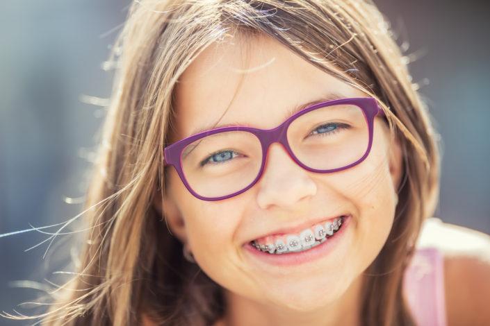 smiling girl with orthodontic braces (ottawa orthodontist blog)
