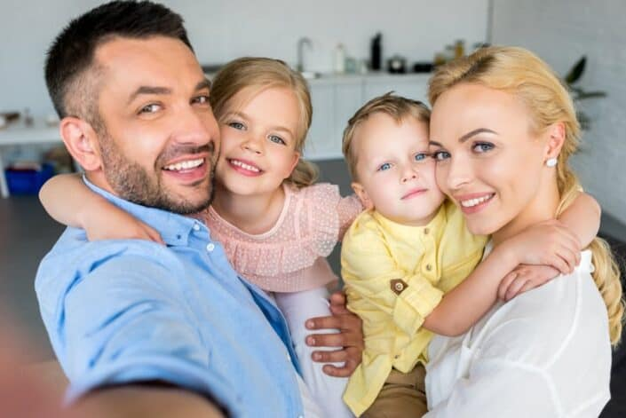 family smiling straighten teeth options blog post image